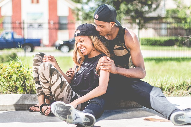 a young black couple sitting together