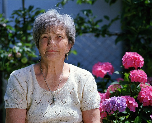 older woman in a garden looking at the camera