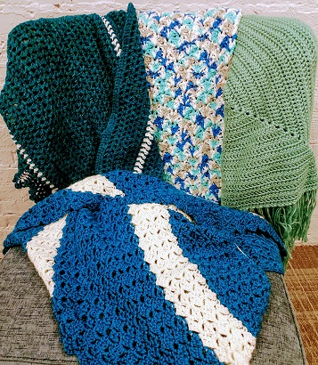A co9llection of woven confort shawls
